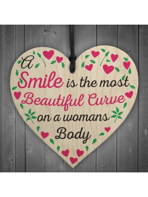 Smile Is The Most Beautiful Curve Wooden Hanging Heart Plaque
