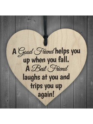 A Best Friend Trips You When You Fall Wooden Hanging Heart